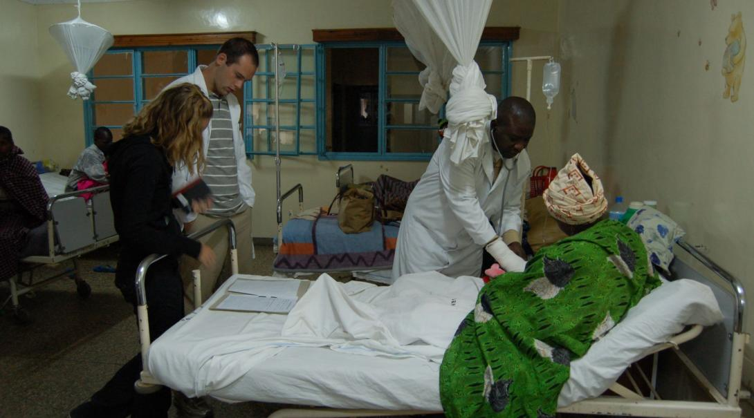 A couple of Projects Abroad volunteers observe the work of a local doctor in the maternity ward of a hospital in Ghana during their midwifery internship.